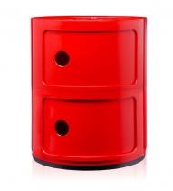 Table d'appoint de la designer Anna Castelli Ferreri. Dans un esprit pop, ce meuble en plastique de lux rouge est devenu un classique de la marque Kartell.